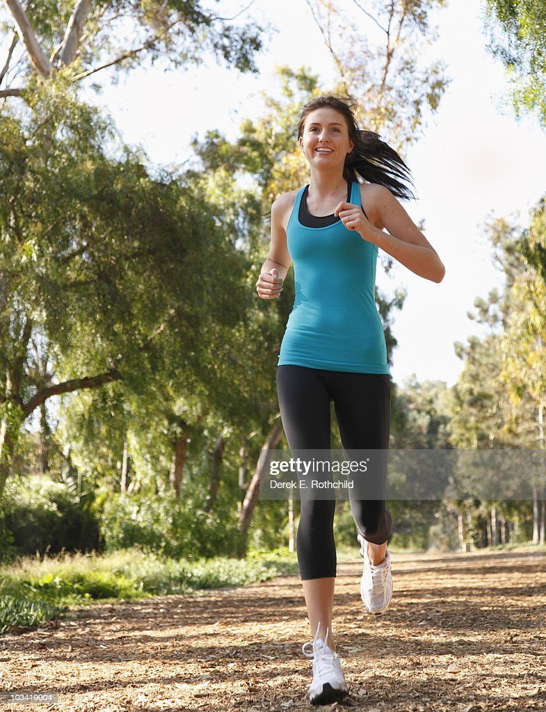 Girl jogging on tree lined path 2 : Stock Photo