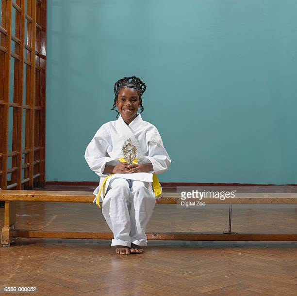 Girl Judoist Holding Trophy