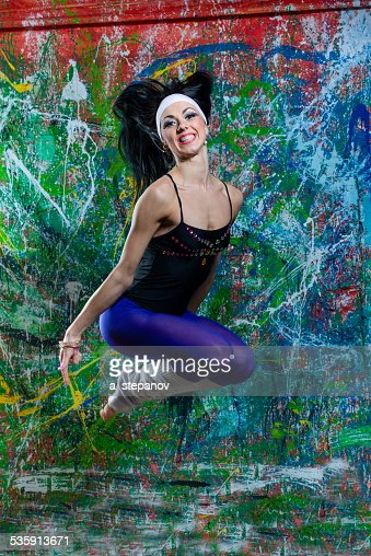 girl jump of art graffiti : Stock Photo