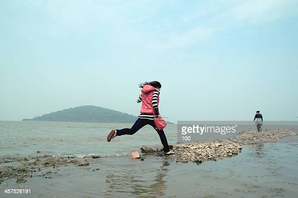 girl jump over water