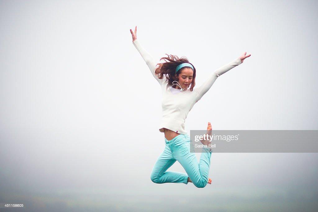 Girl Jumping in the Fog