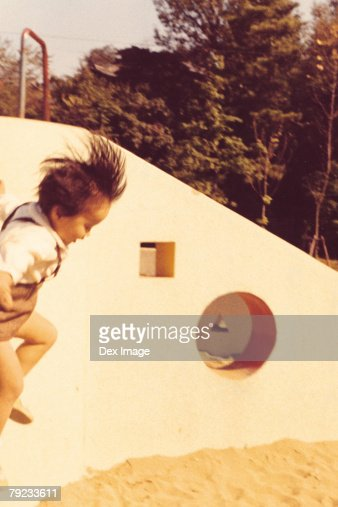 Girl jumping in the playground : Stock Photo