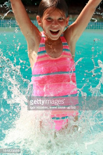 girl jumping in the pool : Stock Photo
