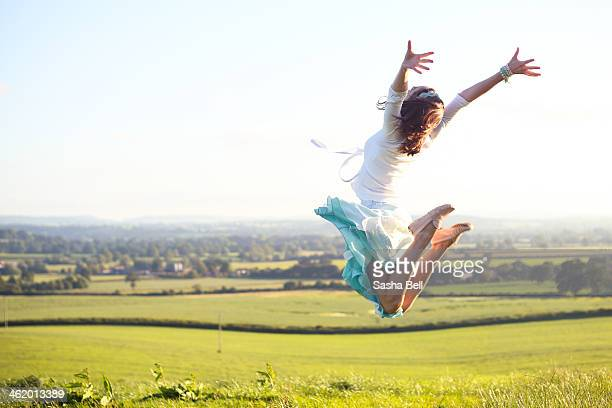 Girl jumping in the summer