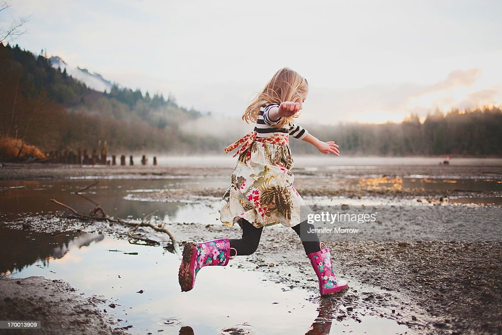 Girl jumping in water