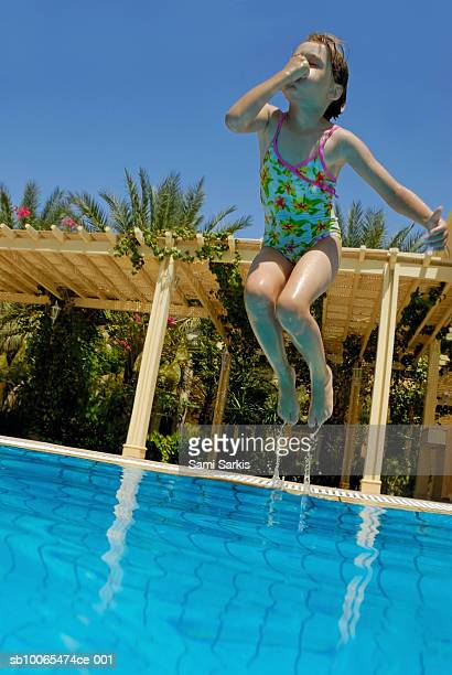 Jump Into The Water Hold Nose Stock Photos And Pictures Getty Images