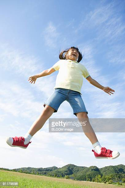 Girl jumping, low angle view
