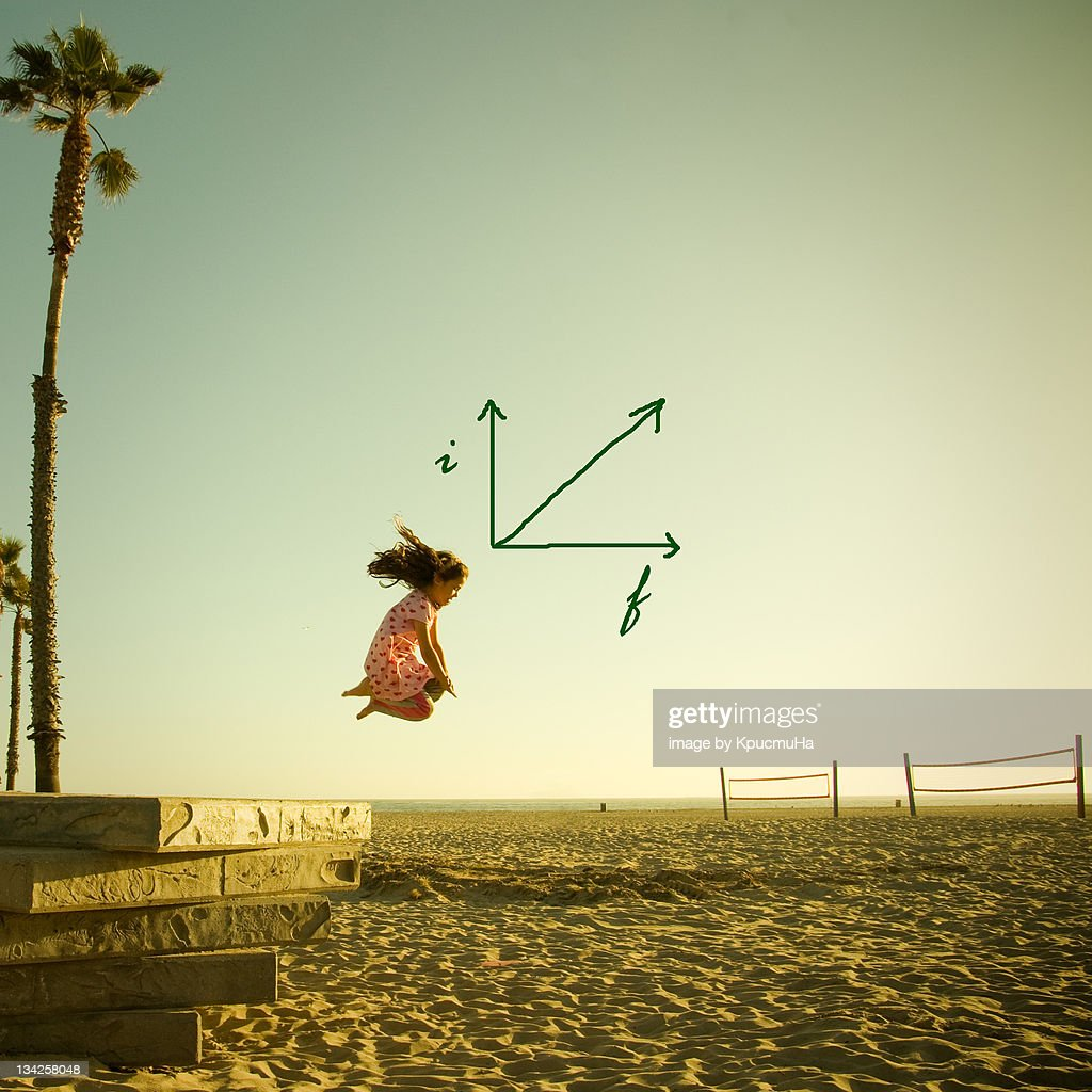 Girl jumping on sand : Stock Photo