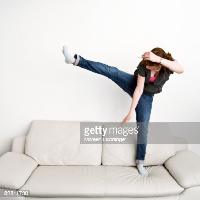 Girl Jumping On White Leather Couch Stock Photo Getty Images