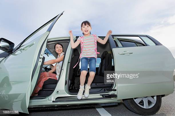 Girl Jumping Out of a Car