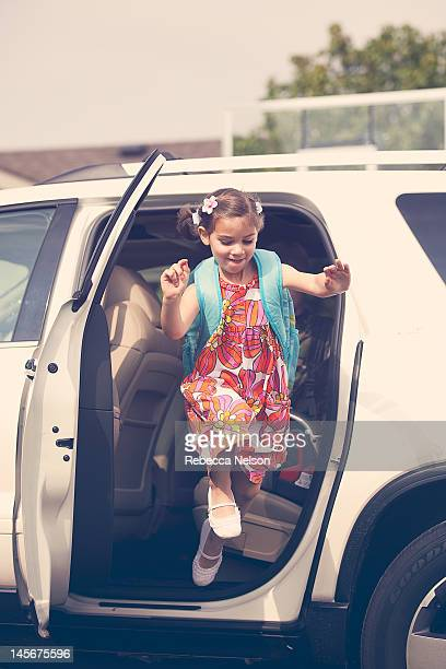 Girl jumping out of car