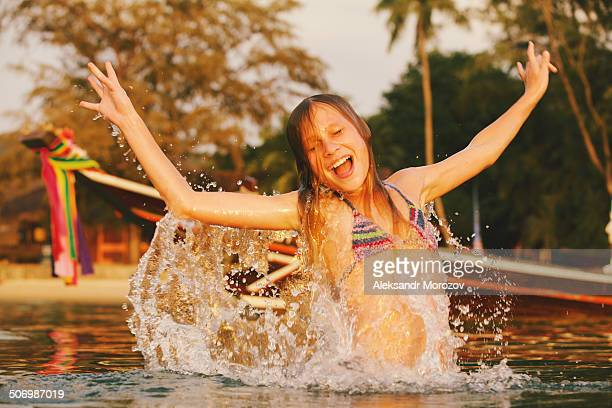 Girl jumping out of water