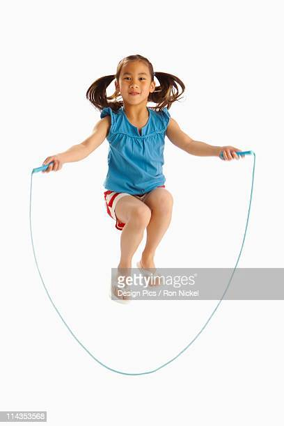 A Girl Jumping With A Skipping Rope