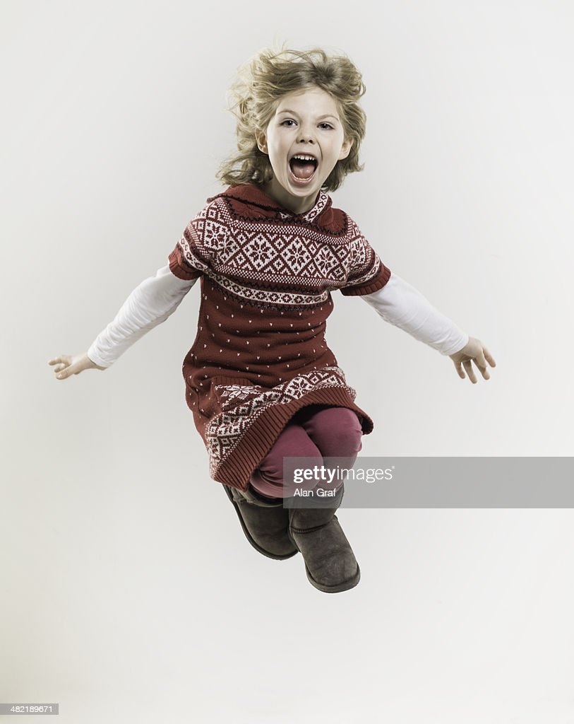 Girl jumping with arms open