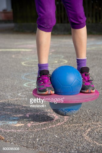 Girl jumping with Moon Hopper, partial view