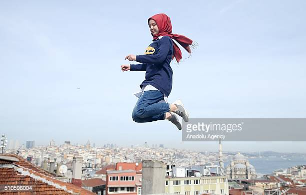 A girl jumps at a park near the Bosphorus during a winter day reminiscent of a summer day in Istanbul Turkey on February 16 2016 This week the...