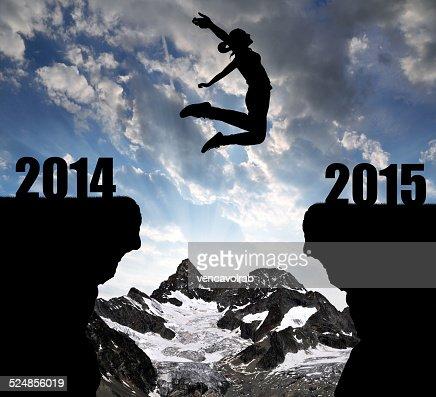 Girl jumps para el nuevo año 2015 : Foto de stock