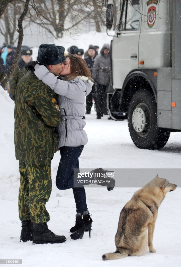A girl kisses a Belarus soldier from an Interior Ministry special unit during a military show marking Maslenitsa holiday on the outskirts of Minsk on March 3, 2013. Maslenitsa is an medieval pagan festival that celebrates the end of winter and the start of spring.