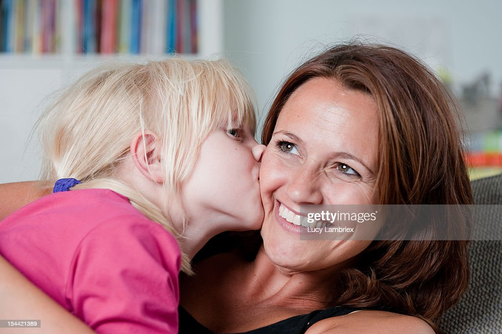 Girl kisses mom : Stock Photo