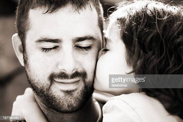 Girl Kissing and Loving Her Father