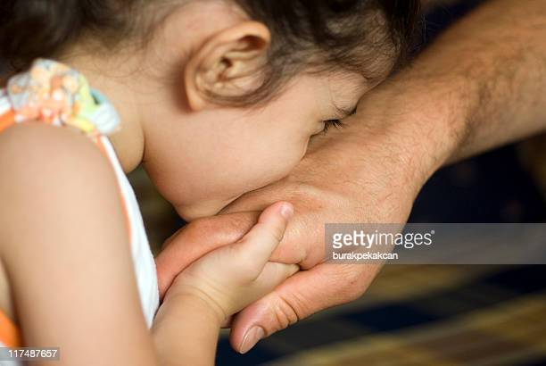Girl kissing father's hand, close-up, Turkey, Istanbul
