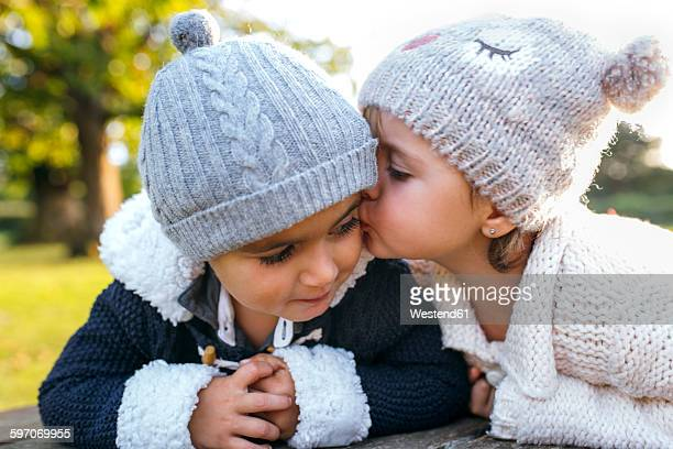 Girl kissing little boy