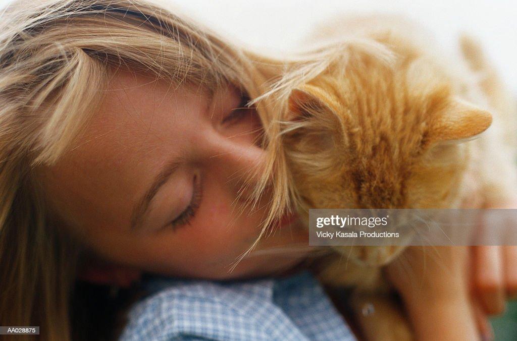 Girl Kissing Orange Cat : Stock Photo