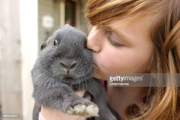 Girl Kissing Rabbit