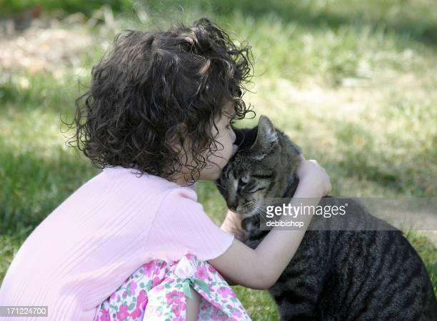Girl Kissing Tabby Cat