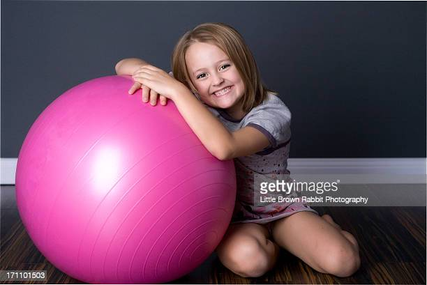 Girl kneeling with a Giant Pink Ball