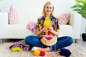 A portrait of a girl knitting at home