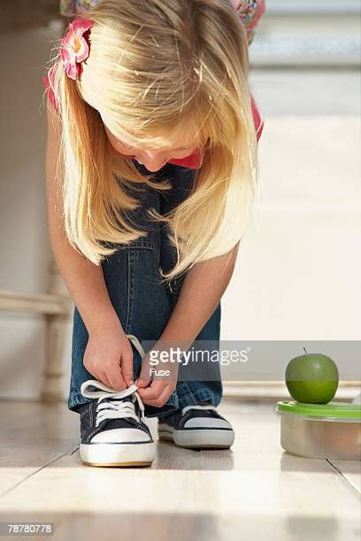 Girl Lacing Her Shoes