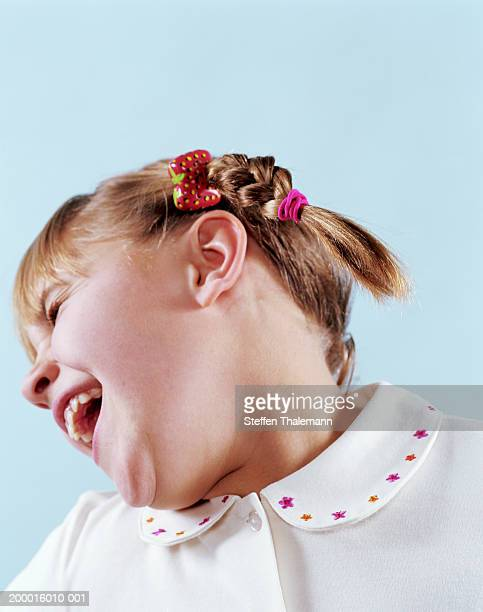 Girl (5-7) laughing, close-up