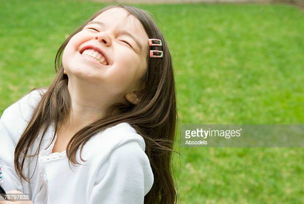 A girl laughing in the garden