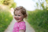 Girl laughing walking along path