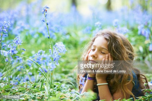 Girl laying in field of flowers : Bildbanksbilder