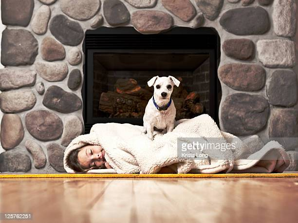 Girl laying in front of fireplace