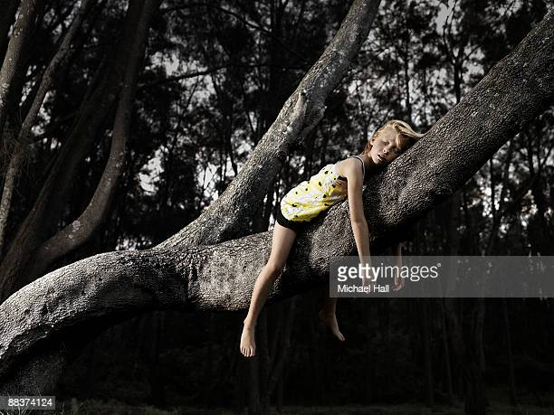 Girl laying in tree branch