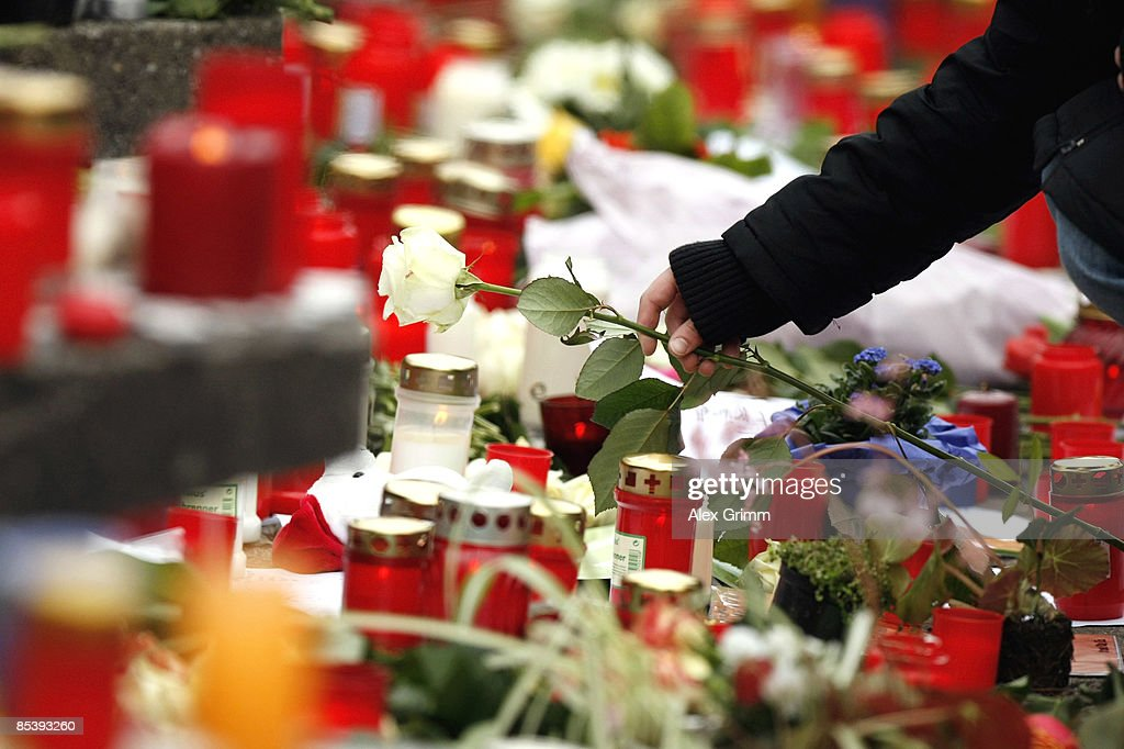 A girl lays down a rose in front of the AlbertvilleSchool Centre on March 12 2009 in Winnenden near Stuttgart Germany 17 year old Tim Kretschmer...