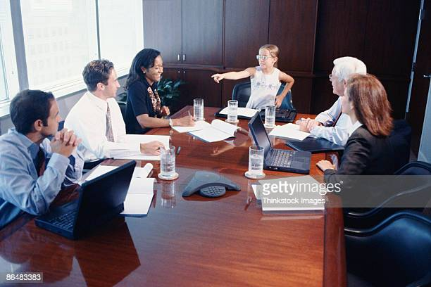 Girl leading business meeting