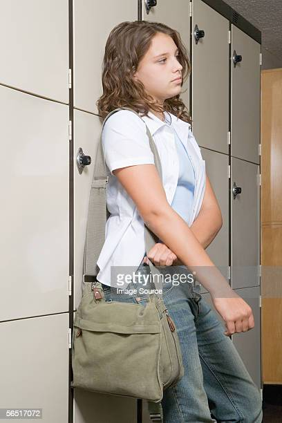 Girl leaning against lockers