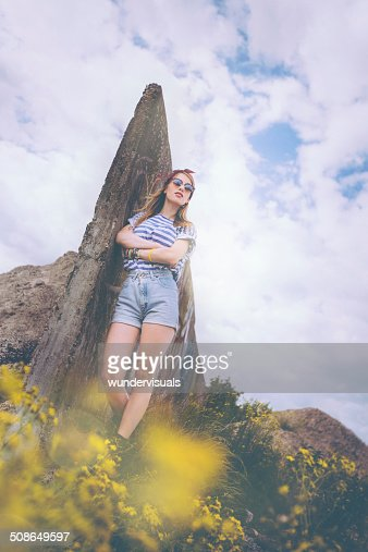 Girl Leaning Against Wall : Stock Photo