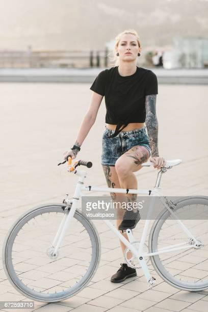 Girl Leaning on a Bike
