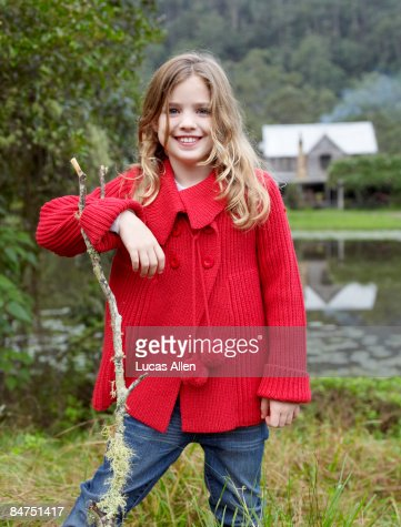 Girl leaning on a stick outdoors : Stock Photo