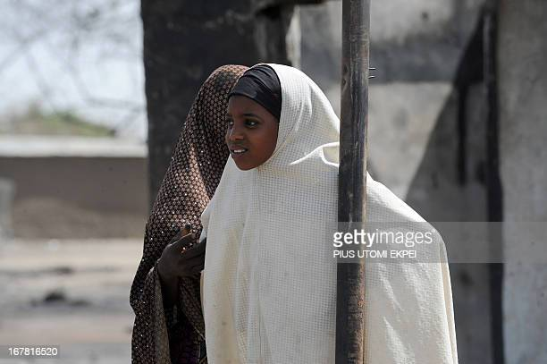 A girl leans on stick on April 30 2013 in the street as normalcy returns after Islamist clash with soldiers on April 25 2013 in the remote northeast...