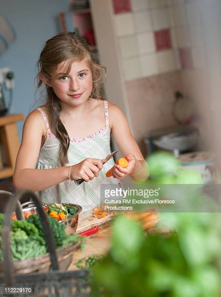 Girl learning cooking organic produce