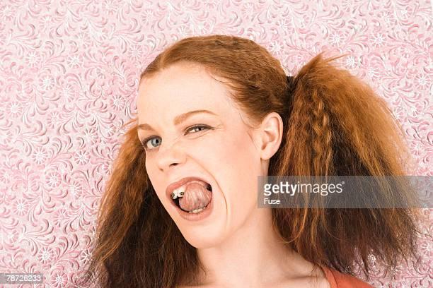 Girl Licking Her Teeth