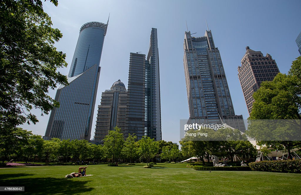 A girl lies on the central greenland of Lujiazui to enjoy the sunshine Located in the Pudong New District on the eastern bank of Huangpu River...