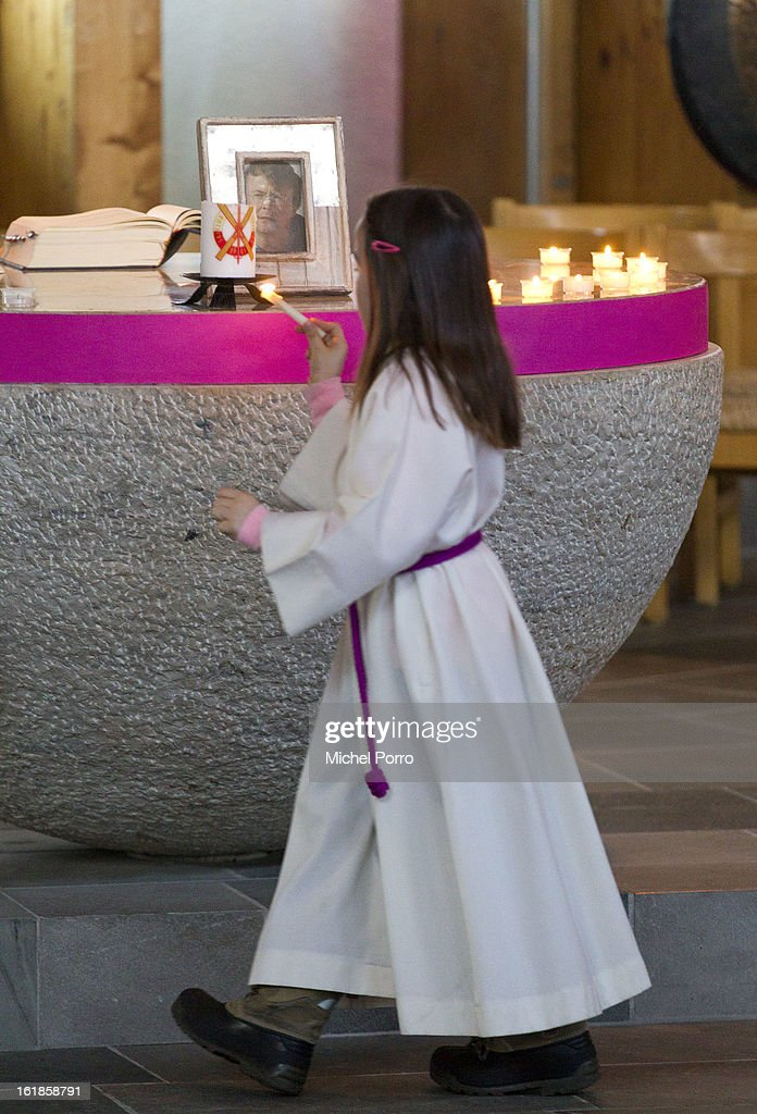 A girl lights a candle beside a framed picture of Prince Friso of The Netherlands before a service of prayers held on the first anniversary of at the ski-ing accident that left Prince Friso critically injured, at Parish Church of St Nicholas on February 17, 2013 in Lech, Austria. Prince Friso of Orange-Nassau (44) second son of Queen Beatrix of The Netherlands, was hit by an avalanche while ski-ing off-piste in the resort of Lech, under which he remained buried for 20 minutes. He suffered brain damage due to shortage of oxygen and has remained in a coma since the accident.