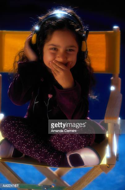 Girl Listening to Headphones and Laughing